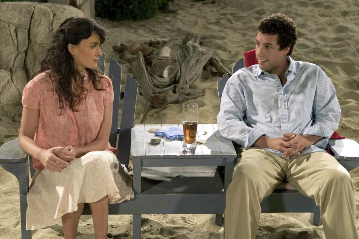 """Flor (Paz Vega) and John (Adam Sandler) talk about their kids in a scene from """"Spanglish."""""""