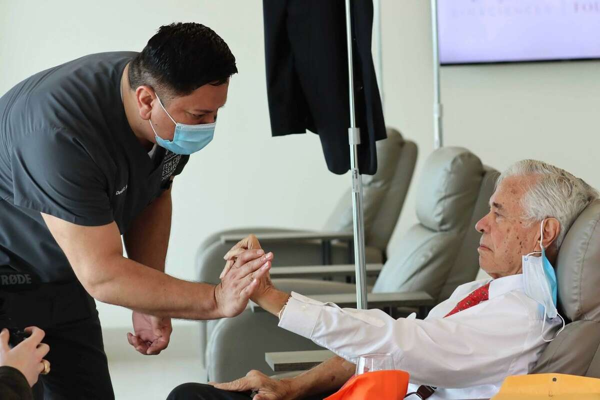 David Gonzalez, a registered nurse with Hope Biosciences Stem Cell Research Foundation interacts with a Parkinson's patient.