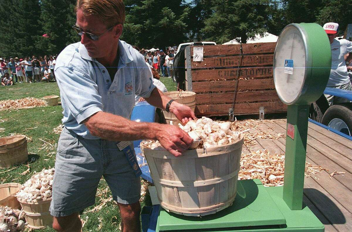 Baskets of garlic are weighed after the garlic topping contest at the 20th Annual Gilroy Garlic Festival in Gilroy, California.