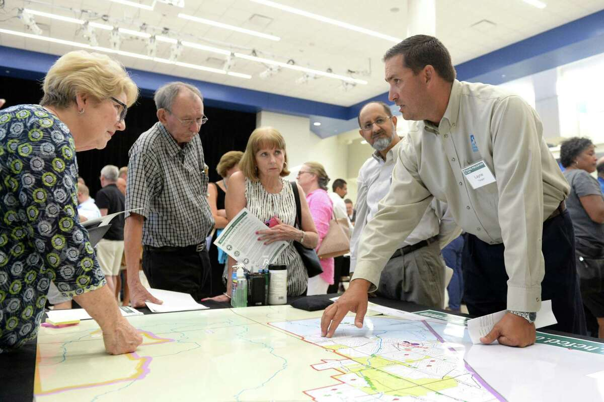 Layne Yeager of the Harris County Flood Control District answers questions from residents at a Harris County Flood Control Community Engagement meeting in Katy, TX, on August 1, 2018, prior to voters' approval of a $2.5 billion flood control bond. Harris County Commissioners Court voted this week to use money from the county toll road authority to make up for part of a $1.4 billion shortfall in flood bond projects.
