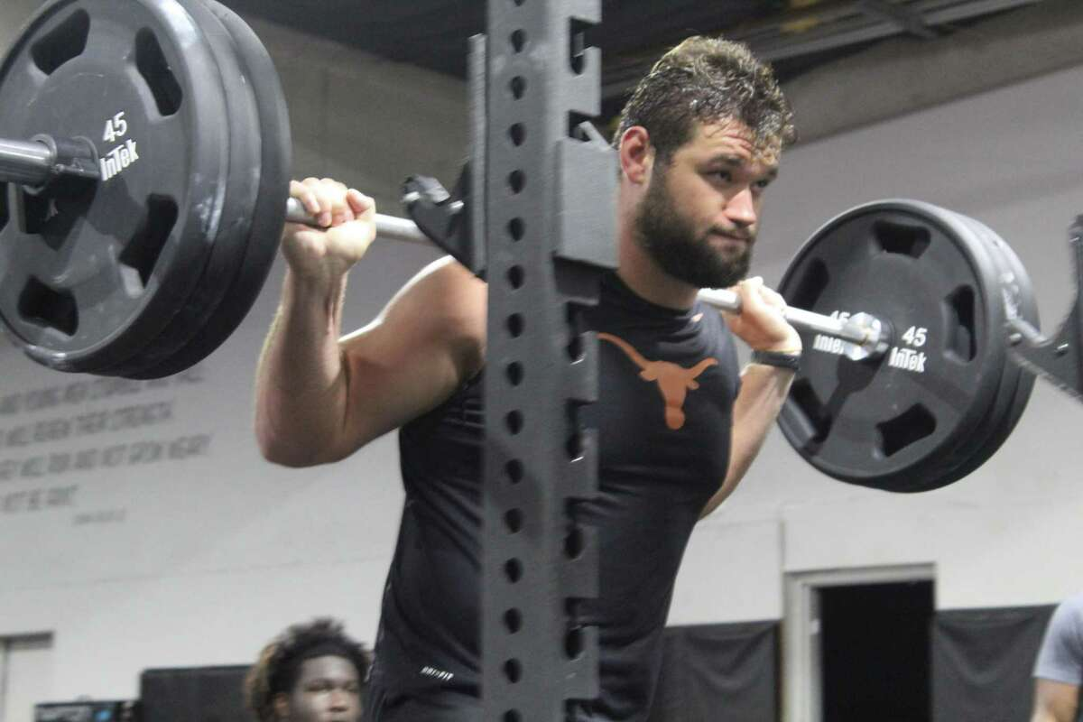 Sam Cosmi, working out at Armed Forces in Atascocita, could go anywhere from late first to third round in the NFL draft.