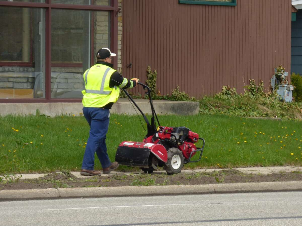 Volunteers prepare sections along U.S. 31 to plant for this year's Blossom Boulevard.