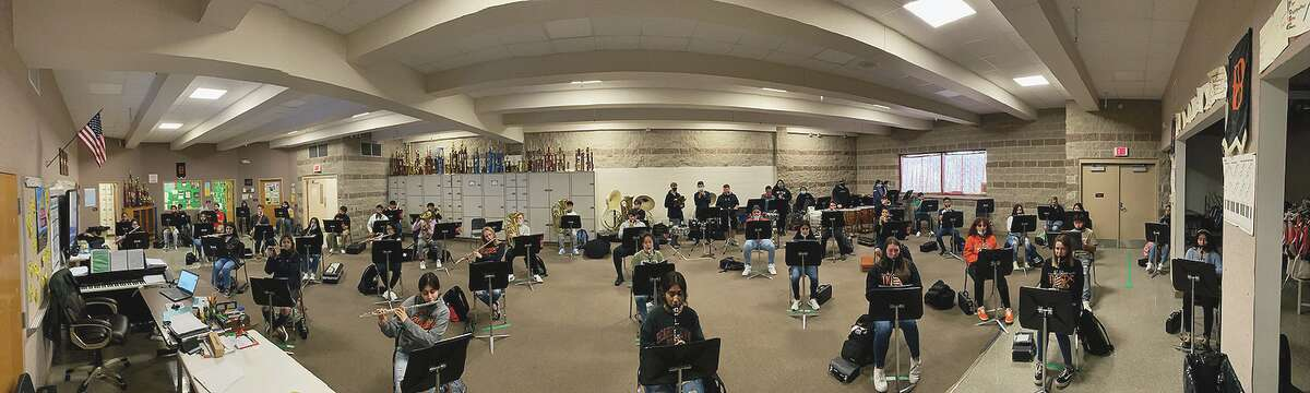 Students from Beardstown High School rehearse in the music room.