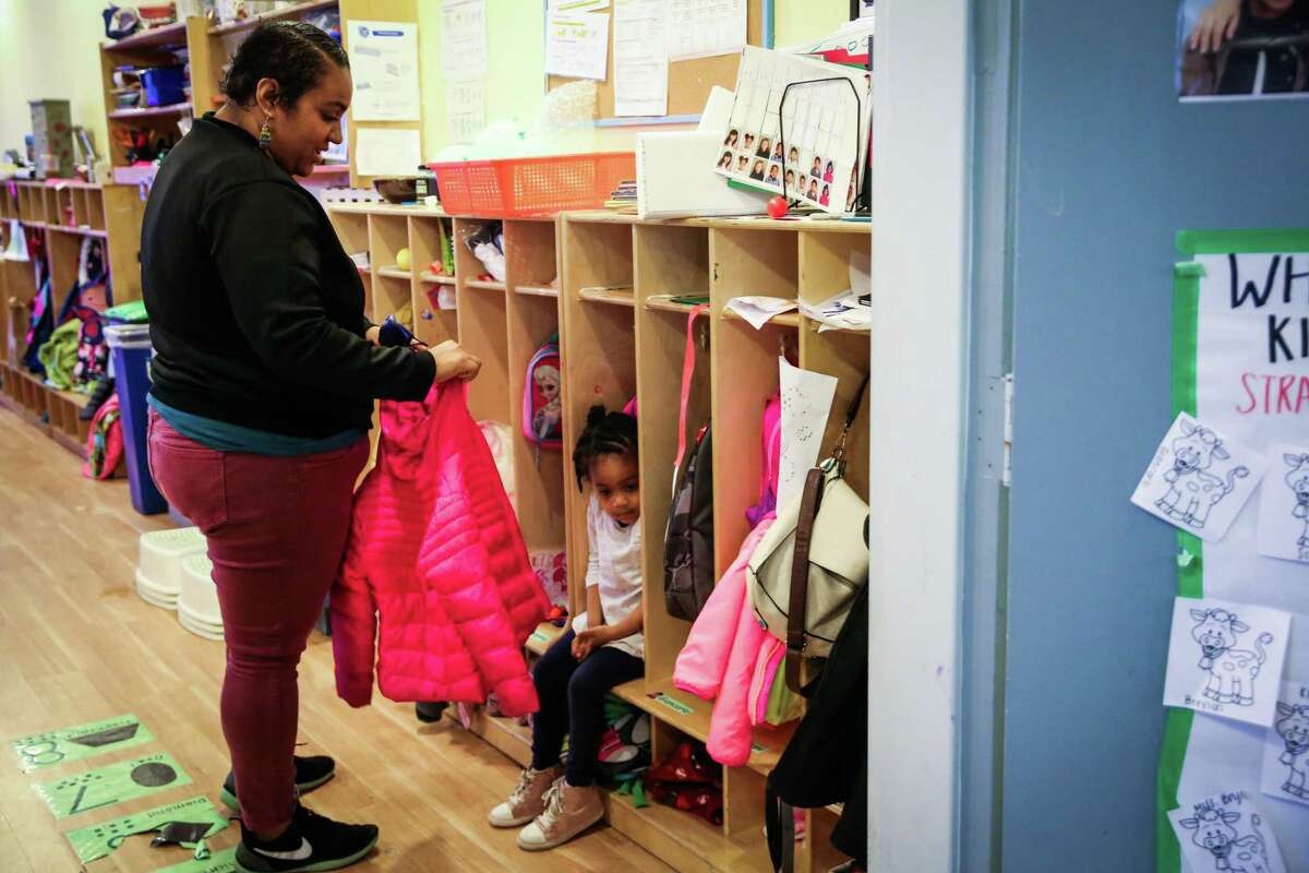 Kailey Norris says goodbye to her daughter Khyla Robinson, 3, at her pre-school in the Haight in San Francisco in 2017. The state Supreme Court has cleared the way for the city to pay for additional child- care and early education services with commercial rent taxes approved by voters in 2018.