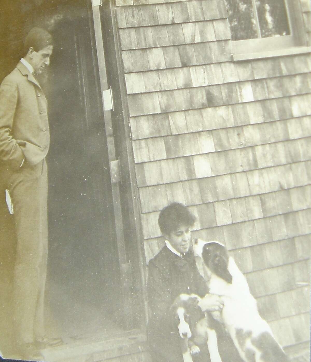 Following Jay Gould's death in 1892 of tuberculosis, his eldest daughter Helen took over management of Lyndhurst. At the request of the youngest Gould, Frank, she added a kennel for St. Bernards on the property, not to breed them for sale, but to show them. Frank is pictured here outside of the kennel with a staff member.