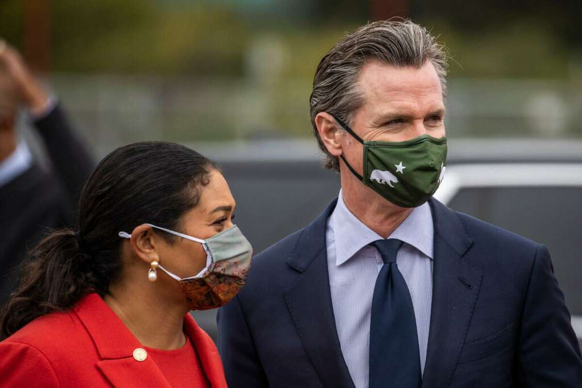 San Francisco Mayor London Breed, left, and California Governor Gavin Newsom are seen after a press conference at the COVID-19 mass vaccination site at City College of San Francisco in San Francisco, California Tuesday, April 6, 2021.