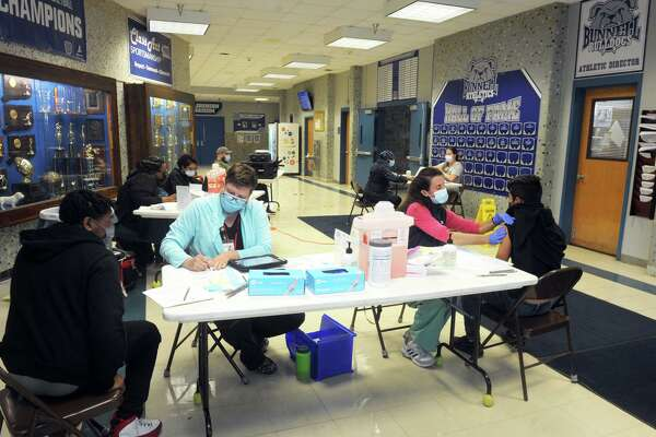 A file photo of a clinic for COVID-19 vaccines offered to students at Bunnell High School in Stratford, Conn. April 28, 2021.