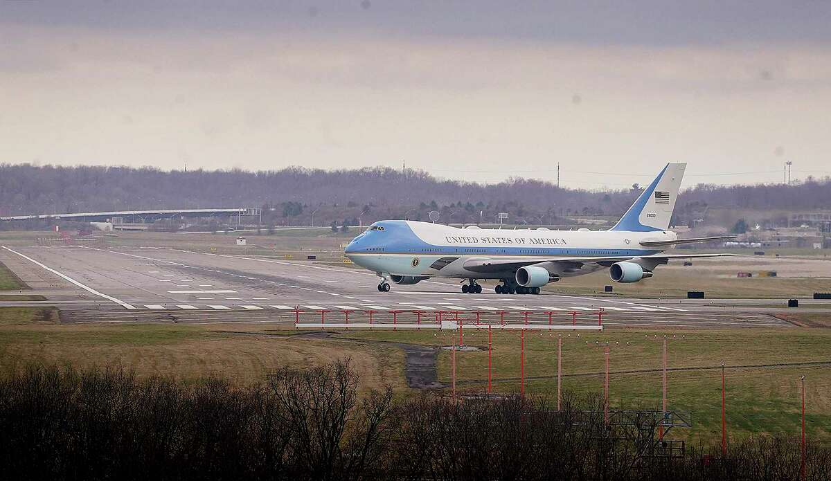 Air Force One lands at the Pittsburgh International Airport Wednesday, March 31, 2021, in Coraopolis, borough west of Pittsburgh. President Joe Biden wants $2 trillion to reengineer America's infrastructure and expects the nation's corporations to pay for it. The Democratic president traveled to Pittsburgh on Wednesday to unveil what would be a hard-hatted transformation of the U.S. economy. (Peter Diana/Pittsburgh Post-Gazette via AP)