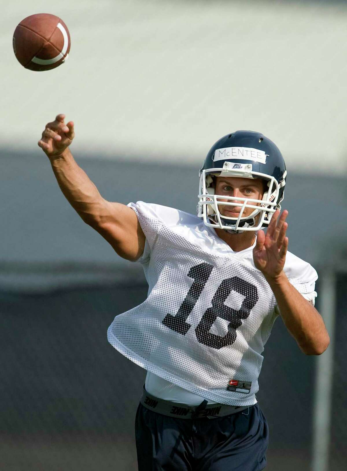 UConn quarterback Johnny McEntee throws during NCAA college football practice in Storrs on Aug. 3, 2012.