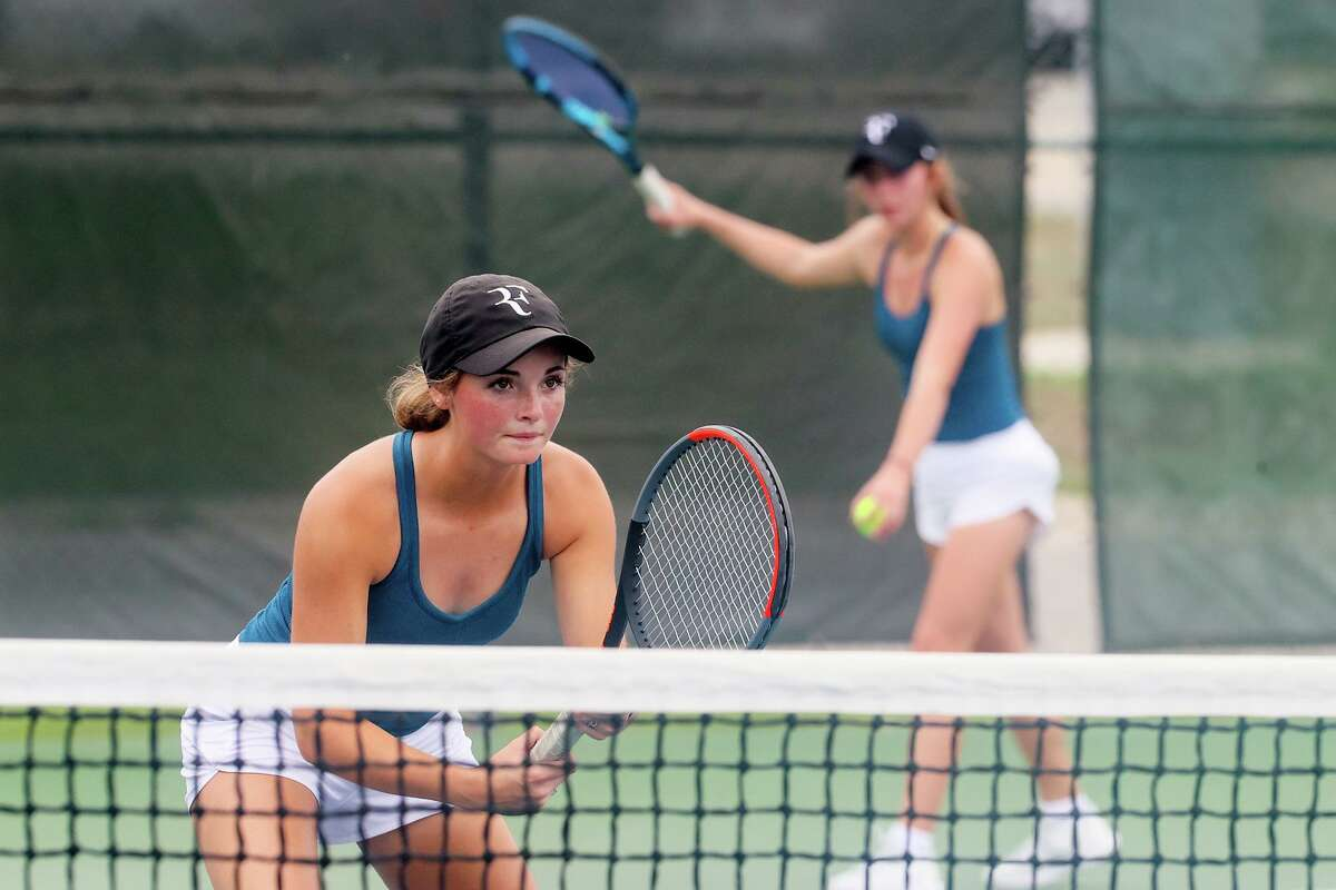 Kerrville Tivy's Lexi Harrel, left and Shayna Meek compete in girls doubles in the Class 5A regional tennis finals at the NEISD Tennis Center on Wednesday, April 28, 2021. Harrel and Meek defeated Corpus Christi Veterans Memorial's Sophie Deng and Jenny Su 6-2, 4-6, 6-3 to take the title.