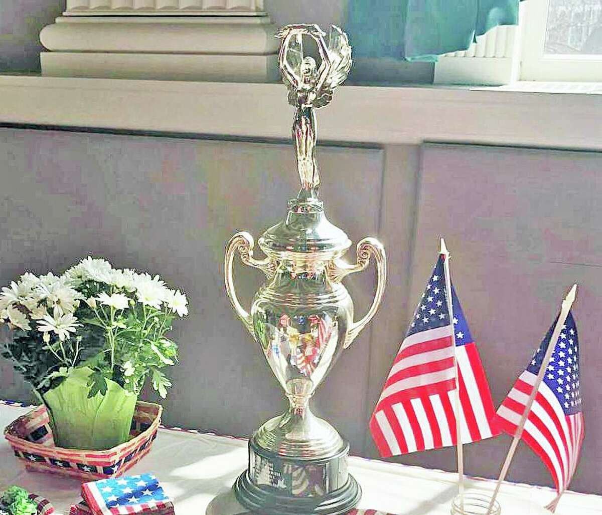 A Democracy Cup trophy, such as this one, was awarded to Newtown by Secretary of State Denise Merrill for having the highest voter turnout in the November 2020 elections for a mid-size town.