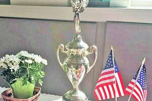File photo. A Democracy Cup trophy, such as this one, was awarded to Newtown by Secretary of State Denise Merrill for having the highest voter turnout in the November 2020 elelections for a mid-size town.