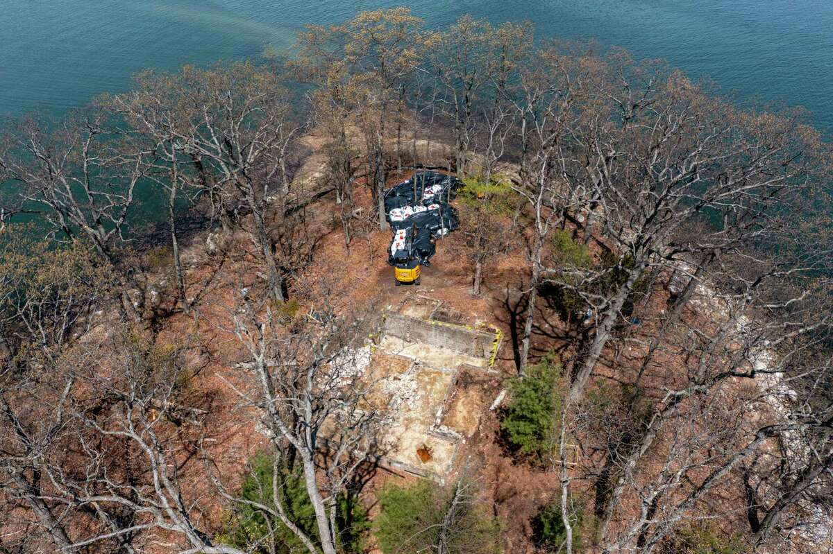 Crews work to remove contaminated soil on Hoyt Island in the Long Island Sound. The Norwalk Land Trust is asking the city for $200,000 to help complete the cleanup effort.