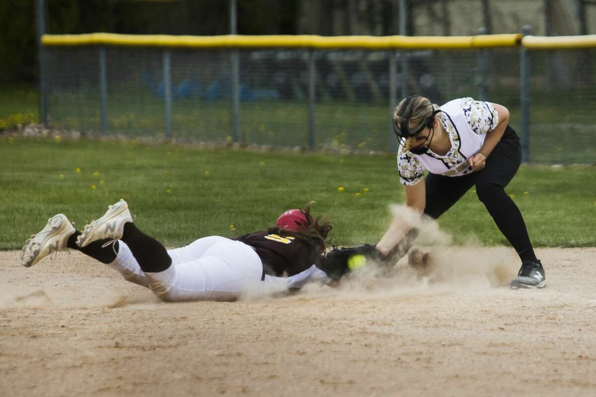 Bullock Creek's Lauren Borsenik attempts to tag out an opponent during the Lancers' game against Ogemaw Heights Wednesday, April 28, 2021 at Bullock Creek High School. (Katy Kildee/kkildee@mdn.net)