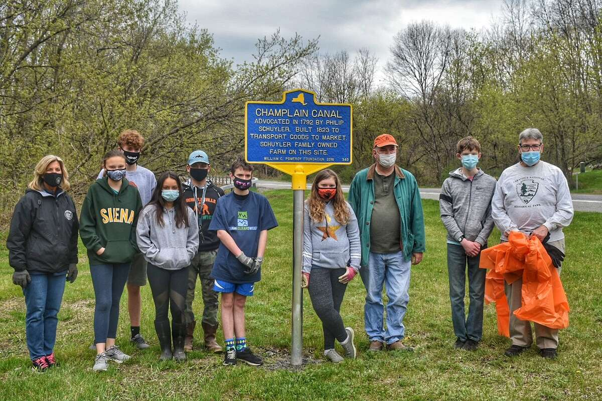 """The Saratoga County History Center participated in the statewide """"Spring Cleaning"""" activities along the State Canal System, April 24-25 to mark Earth Day 2021. The multi-community celebration resulted from a partnership between the State Canal Corporation and Parks & Trails New York.  On Saturday, April 24, trustees, staff, and members of the History Center teamed-up with the Quaker Springs Country Kids 4-H Club to clean up the Old Champlain Towpath Canal Trail in the towns of Saratoga and Stillwater.  The following day, History Center folks were joined by State Sen. Daphne Jordan (R-Halfmoon), Saratoga Deputy Town Supervisor Michael McLaughlin, and students from the Notre Dame Visitation Church School to restore the March to Surrender Canal Trail in Saratoga."""