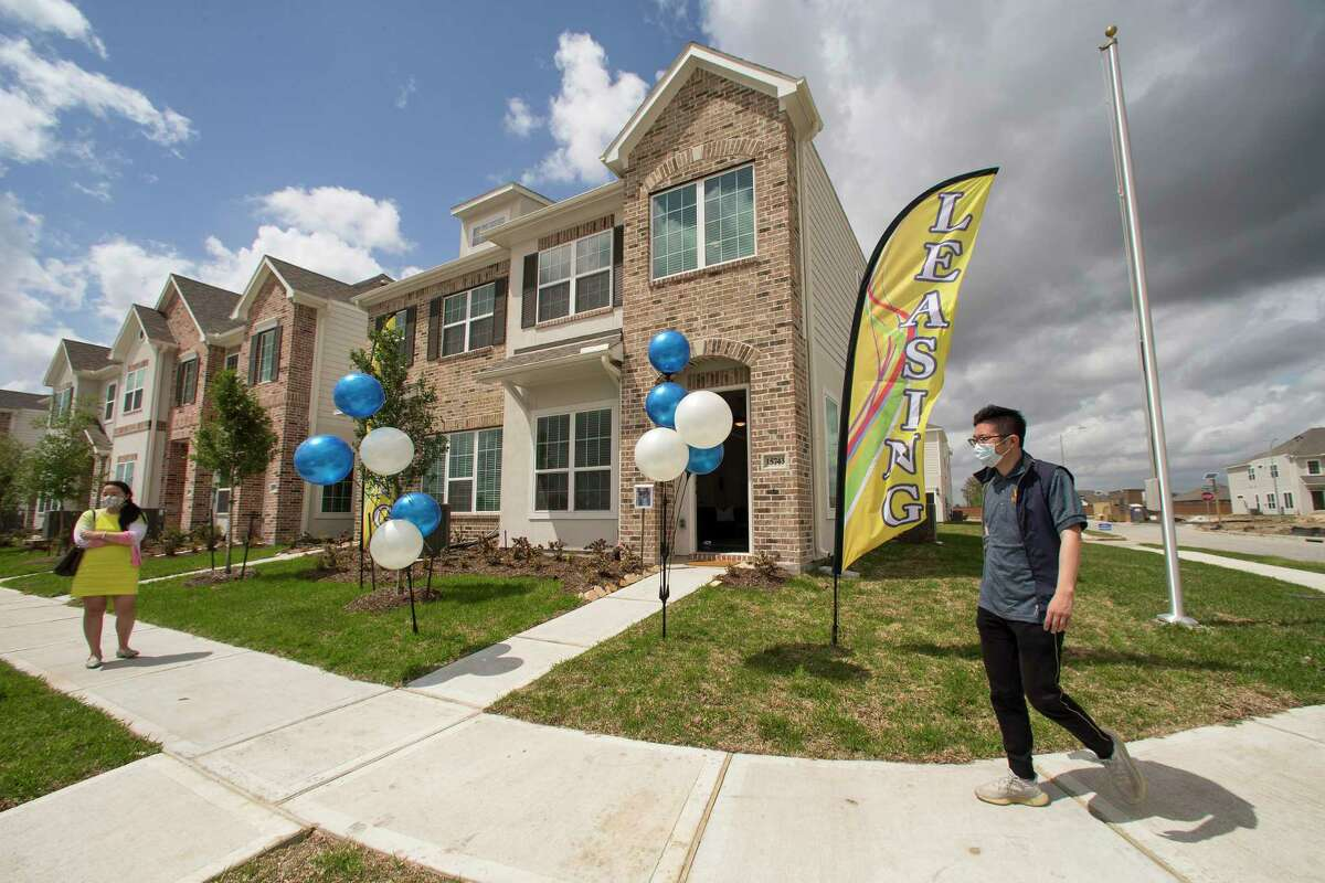 Tung Qiao, CEO of Wan Bridge Group, walks past a row of single family townhomes that are completed and ready to lease in the Clearwater at Balmoral subdivision Tuesday, April 6, 2021 in Atascocita. Single-family rentals are drawing increased interest from investors making the bet that people want to live in single-family houses but either will not be able to afford to buy or want to maintain their amenity-rich turnkey lifestyle.