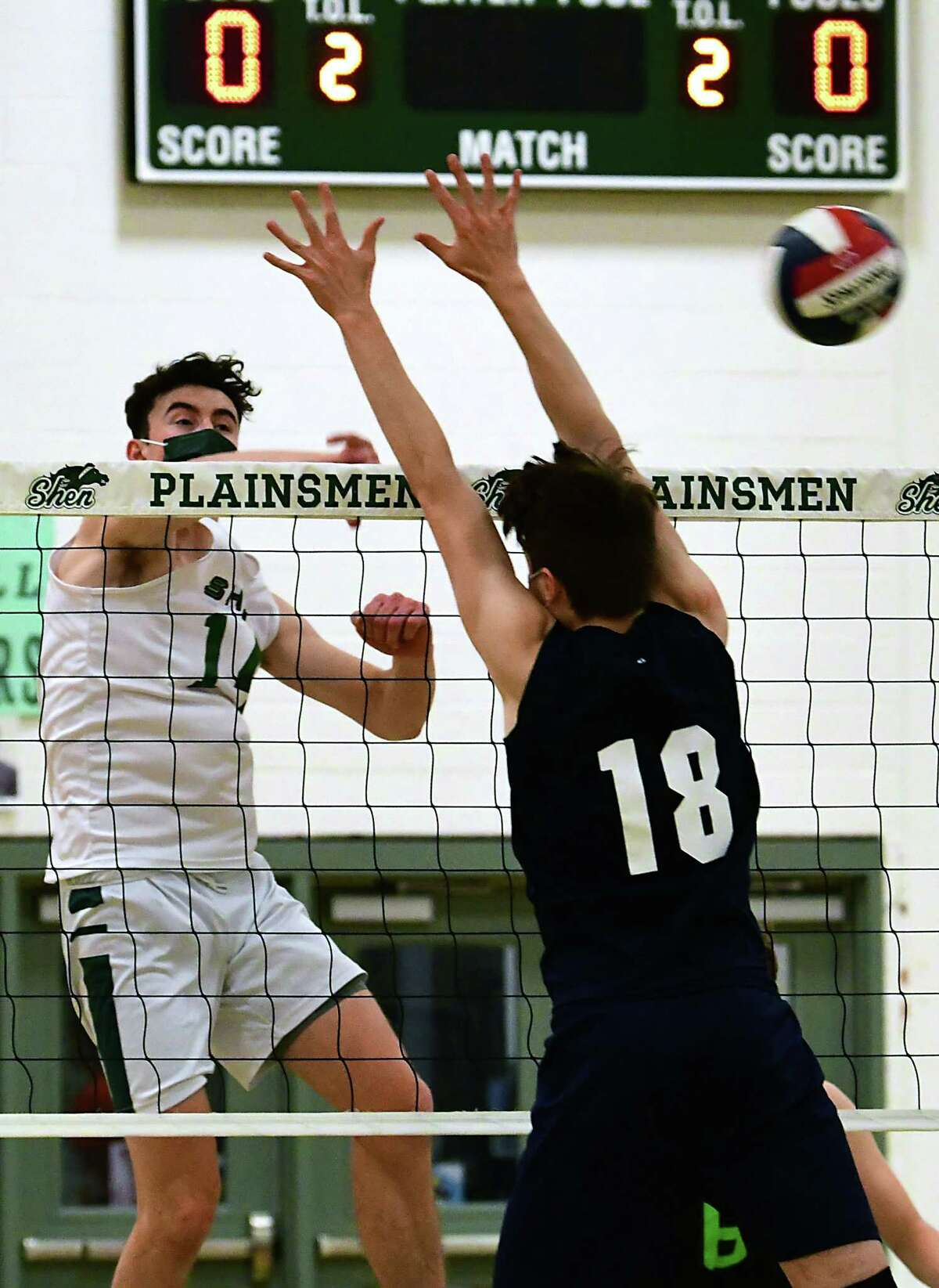 Shenendehowa's Will Licata spikes the ball past Columbia's Gabe Tucker during a volleyball game on Wednesday, April 28, 2021 in Clifton Park, N.Y. (Lori Van Buren/Times Union)