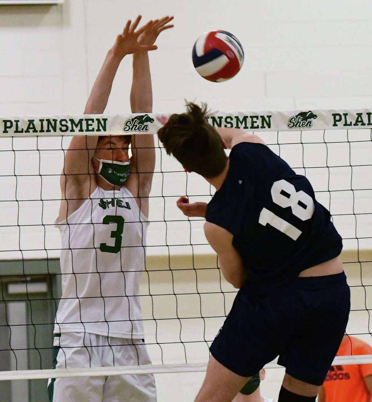 Shenendehowa's Jason Aubrey blocks a spike from Columbia's Gabe Tucker during a volleyball game on Wednesday, April 28, 2021 in Clifton Park, N.Y. (Lori Van Buren/Times Union)