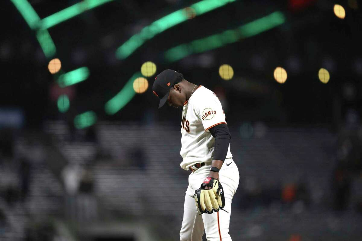 San Francisco Giants' Gregory Santos stands on the mound after giving up a home run to Colorado Rockies' C.J. Cron during the 10th inning of Tuesday's game.