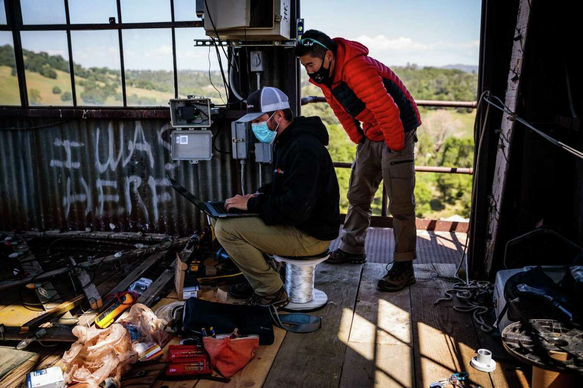 ALERTWildfire technicians work to install a camera at the Kennedy Gold Mine in Jackson, California on April 21.