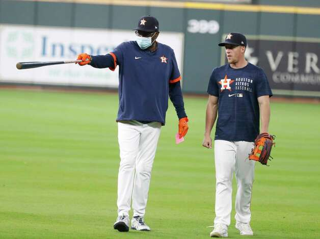 Houston Astros manager Dusty Baker Jr. chats with Myles Straw during batting practice before the start of an MLB baseball game at Minute Maid Park, Wednesday, April 28, 2021, in Houston. Photo: Karen Warren, Staff Photographer / @2021 Houston Chronicle