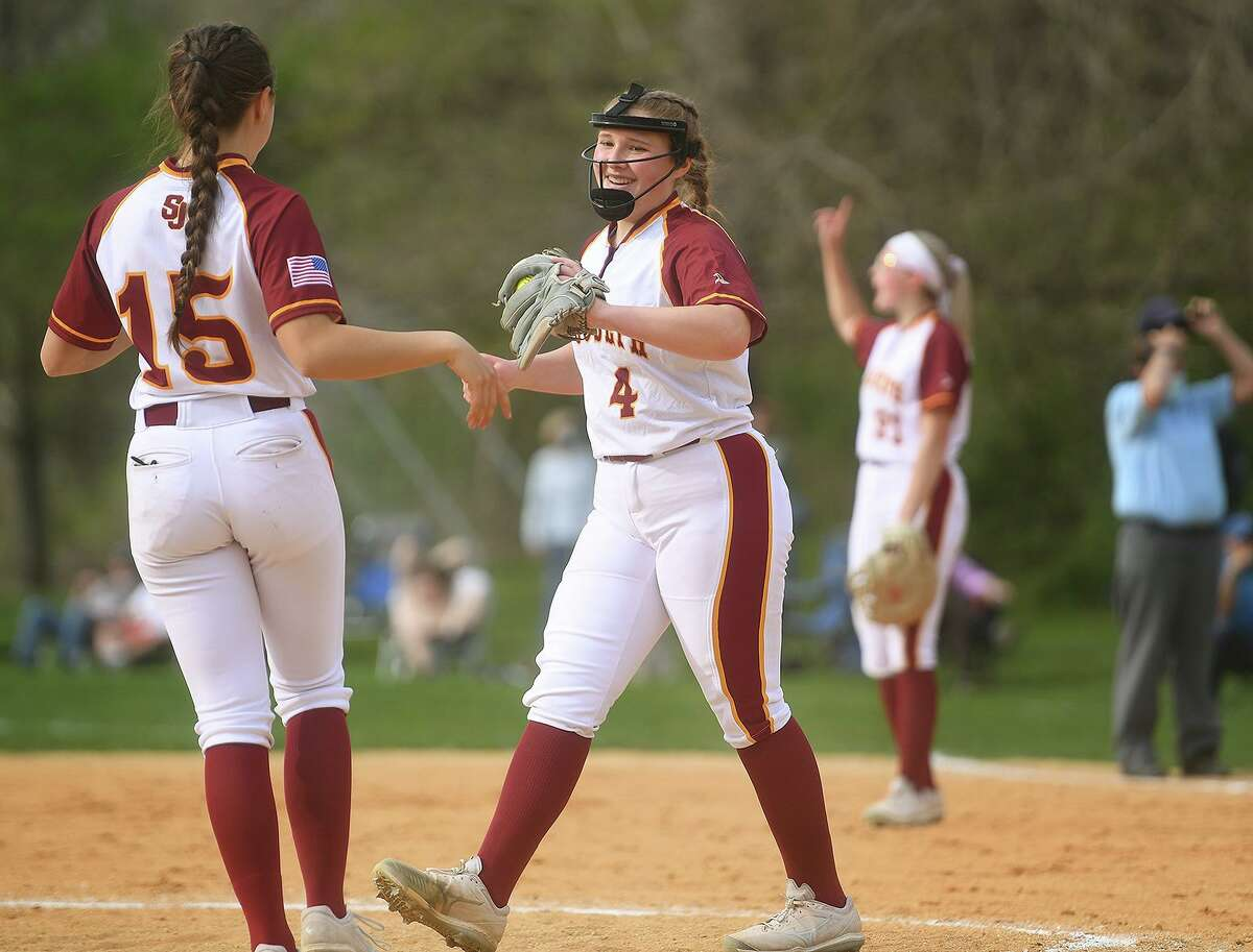 St. Joseph's Coco Bartone, left, congratulates pitcher Lauren Wasikowski during their FCIAC softball game at Sturges Park in Fairfield, Conn. on Wednesday, April 28, 2021.