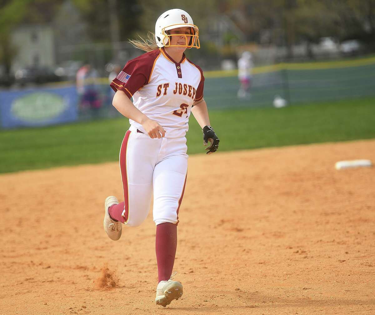 St. Joseph's Maddy Fitzgerald rounds third base after clocking a 3rd inning home run during their FCIAC softball game with Fairfield Ludlowe at Sturges Park in Fairfield, Conn. on Wednesday, April 28, 2021.