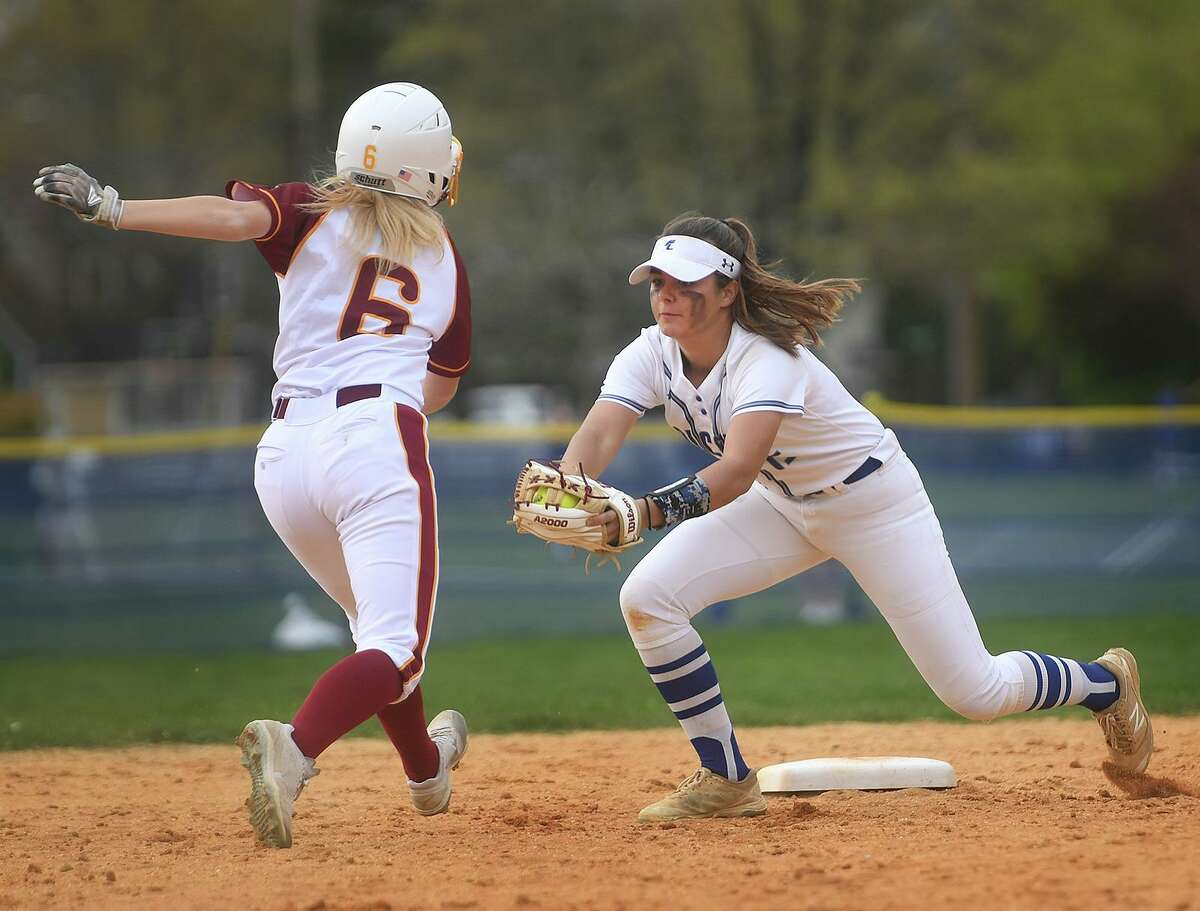 St. Joseph's Kristen Ruby, left, is caught off second base by Fairfield Ludlowe shortstop Allie Clark in the 4th inning of their FCIAC softball game at Sturges Park in Fairfield, Conn. on Wednesday, April 28, 2021.