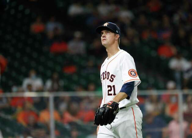 Houston Astros starting pitcher Zack Greinke (21) walks back to the dugout after the fourth inning of an MLB baseball game at Minute Maid Park, Wednesday, April 28, 2021, in Houston. Photo: Karen Warren, Staff Photographer / @2021 Houston Chronicle