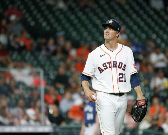 Houston Astros starting pitcher Zack Greinke (21) reacts after issuing a second walk in a row to Seattle Mariners Taylor Trammell during the fourth inning of an MLB baseball game at Minute Maid Park, Wednesday, April 28, 2021, in Houston. Photo: Karen Warren, Staff Photographer / @2021 Houston Chronicle