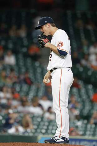 Houston Astros starting pitcher Zack Greinke (21) reacts after giving up a home run to Seattle Mariners Luis Torrens during the third inning of an MLB baseball game at Minute Maid Park, Wednesday, April 28, 2021, in Houston. Photo: Karen Warren, Staff Photographer / @2021 Houston Chronicle
