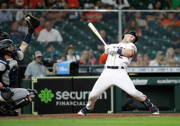 Houston Astros Alex Bregman (2) leans back from a pitch inside from Seattle Mariners starting pitcher Justin Dunn during the third inning of an MLB baseball game at Minute Maid Park, Wednesday, April 28, 2021, in Houston. Photo: Karen Warren, Staff Photographer / @2021 Houston Chronicle