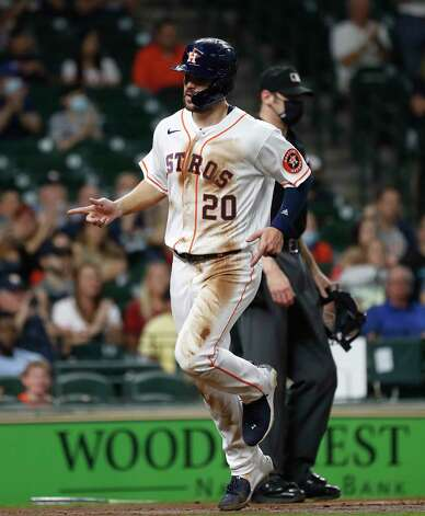 Houston Astros Chas McCormick (20) scores a run on Myles Straw's RBI single during the second inning of an MLB baseball game at Minute Maid Park, Wednesday, April 28, 2021, in Houston. Photo: Karen Warren, Staff Photographer / @2021 Houston Chronicle
