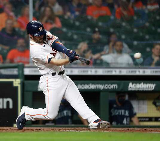 Houston Astros Chas McCormick (20) hits an RBI single during the second inning of an MLB baseball game at Minute Maid Park, Wednesday, April 28, 2021, in Houston. Photo: Karen Warren, Staff Photographer / @2021 Houston Chronicle