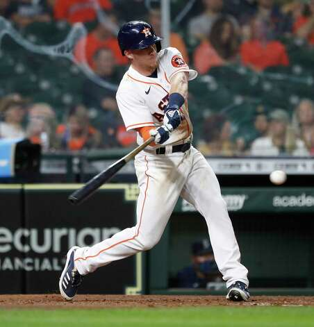 Houston Astros Myles Straw (3) singles during the fifth inning of an MLB baseball game at Minute Maid Park, Wednesday, April 28, 2021, in Houston. Photo: Karen Warren, Staff Photographer / @2021 Houston Chronicle