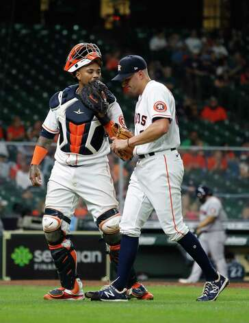 Houston Astros catcher Martin Maldonado (15) has a pep talk with  relief pitcher Brandon Bielak (64) during the fifth inning of an MLB baseball game at Minute Maid Park, Wednesday, April 28, 2021, in Houston. Photo: Karen Warren, Staff Photographer / @2021 Houston Chronicle