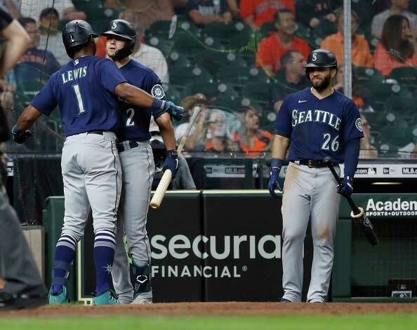 Seattle Mariners Kyle Lewis (1) celebrates his home run with Evan White (12) off of Houston Astros relief pitcher Brandon Bielak (64) during the fifth inning of an MLB baseball game at Minute Maid Park, Wednesday, April 28, 2021, in Houston. Photo: Karen Warren, Staff Photographer / @2021 Houston Chronicle