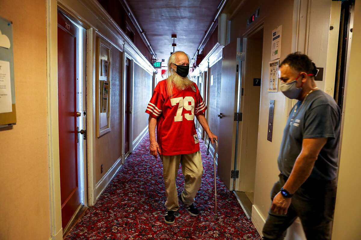 John Susoeff, 77, catches an elevator in March at the Granada Hotel in San Francisco, where he has lived for 16 years. Gov. Gavin Newsom proposes to devote another $9 billion to convert motels and hotels into supportive housing for homeless people.