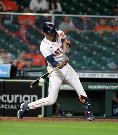 Houston Astros Carlos Correa (1) reaches on an RBI fielder's choice on a throwing error during the eighth inning of an MLB baseball game at Minute Maid Park, Wednesday, April 28, 2021, in Houston. Photo: Karen Warren, Staff Photographer / @2021 Houston Chronicle