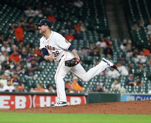 Houston Astros relief pitcher Joe Smith (38) pitches during the eighth inning of an MLB baseball game at Minute Maid Park, Wednesday, April 28, 2021, in Houston. Photo: Karen Warren, Staff Photographer / @2021 Houston Chronicle