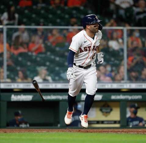 Houston Astros Jose Altuve (27) reacts as he lined out to Seattle Mariners center fielder Kyle Lewis during the seventh inning of an MLB baseball game at Minute Maid Park, Wednesday, April 28, 2021, in Houston. Photo: Karen Warren, Staff Photographer / @2021 Houston Chronicle