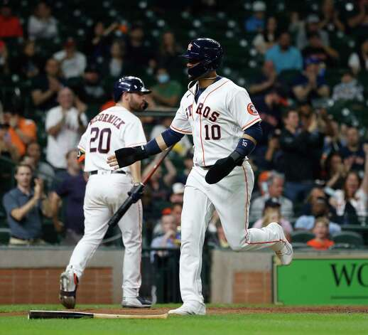 Houston Astros Yuli Gurriel (10) scores a run on Carlos Correa's RBI single during the sixth inning of an MLB baseball game at Minute Maid Park, Wednesday, April 28, 2021, in Houston. Photo: Karen Warren, Staff Photographer / @2021 Houston Chronicle