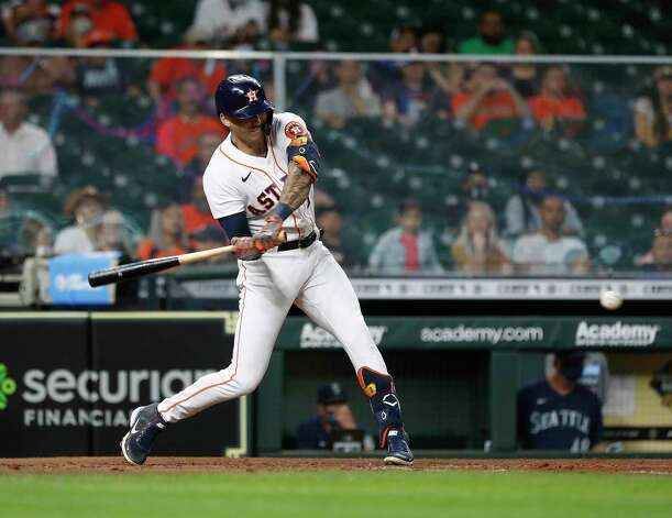 Houston Astros Carlos Correa (1) hits an RBI single off of Seattle Mariners Casey Sadler during the sixth inning of an MLB baseball game at Minute Maid Park, Wednesday, April 28, 2021, in Houston. Photo: Karen Warren, Staff Photographer / @2021 Houston Chronicle