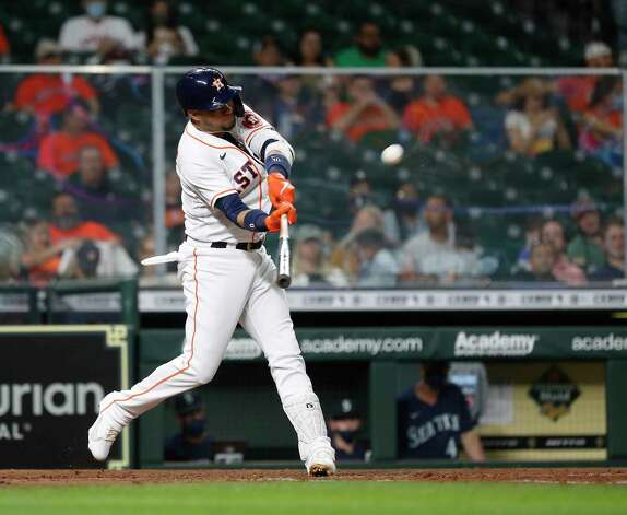 Houston Astros Yuli Gurriel (10) hits a double during the sixth inning of an MLB baseball game at Minute Maid Park, Wednesday, April 28, 2021, in Houston. Photo: Karen Warren, Staff Photographer / @2021 Houston Chronicle