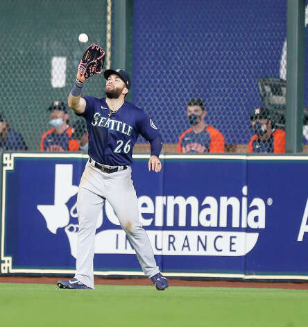 Seattle Mariners right fielder Jose Marmolejos (26) catches Alex Bregman's fly out during the sixth inning of an MLB baseball game at Minute Maid Park, Wednesday, April 28, 2021, in Houston. Photo: Karen Warren, Staff Photographer / @2021 Houston Chronicle