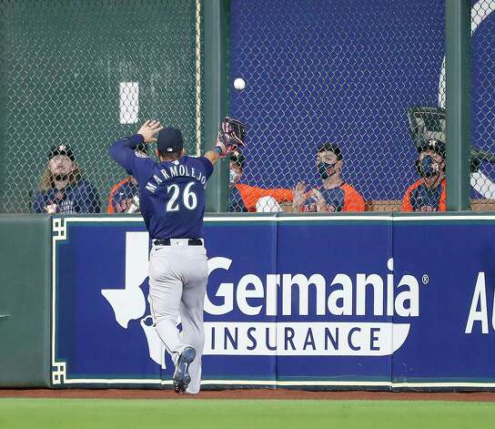 Seattle Mariners Jose Marmolejos (26) tries to catch Houston Astros Yuli Gurriel's double during the sixth inning of an MLB baseball game at Minute Maid Park, Wednesday, April 28, 2021, in Houston. Photo: Karen Warren, Staff Photographer / @2021 Houston Chronicle