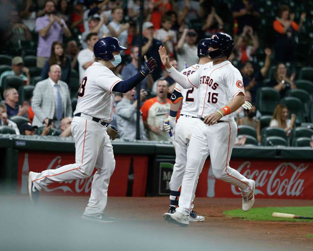 Houston Astros Aledmys Diaz celebrates after he scored a run on Jose Altuve's sac fly during the eighth inning of an MLB baseball game at Minute Maid Park, Wednesday, April 28, 2021, in Houston.