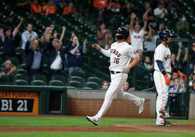 Houston Astros Aledmys Diaz scores a run on Jose Altuve's  sac fly during the eighth inning of an MLB baseball game at Minute Maid Park, Wednesday, April 28, 2021, in Houston. Photo: Karen Warren, Staff Photographer / @2021 Houston Chronicle