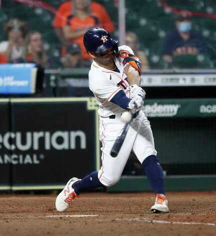 Houston Astros Jose Altuve (27) hits a sac fly allowing Aledmys Diaz to score a run during the eighth inning of an MLB baseball game at Minute Maid Park, Wednesday, April 28, 2021, in Houston. Photo: Karen Warren, Staff Photographer / @2021 Houston Chronicle