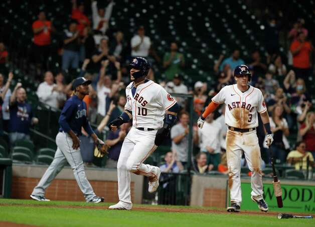 Houston Astros Yuli Gurriel (10) scores a run on Aledmys Diaz's RBI single during the eighth inning of an MLB baseball game at Minute Maid Park, Wednesday, April 28, 2021, in Houston. Photo: Karen Warren, Staff Photographer / @2021 Houston Chronicle